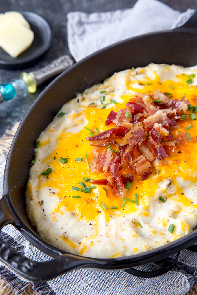 """Instant Pot Loaded Cauliflower Mashed """"Potatoes""""( Keto, Low Carb) - Cauliflower mashed """"potatoes"""" mixed with butter, sour cream, ranch dressing spices and topped with cheddar cheese, bacon and chives. Only 152 calories and 3.5 g net carbs per serving."""