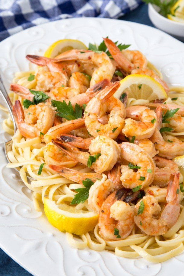 Quick + Easy Instant Pot Shrimp Scampi- Crazy good! Shrimp served in a lemony butter and garlic sauce with a touch of white wine. A restaurant quality meal made at home in a matter of minutes! {Low-carb, Keto and GF options}