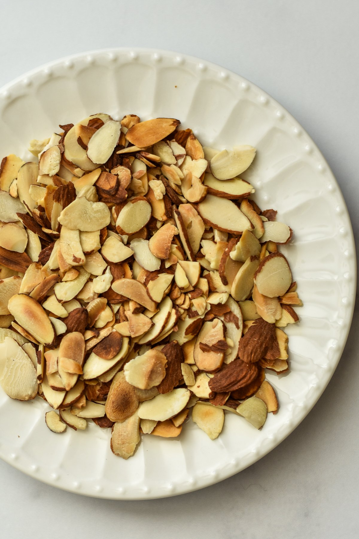toasted almonds on a plate