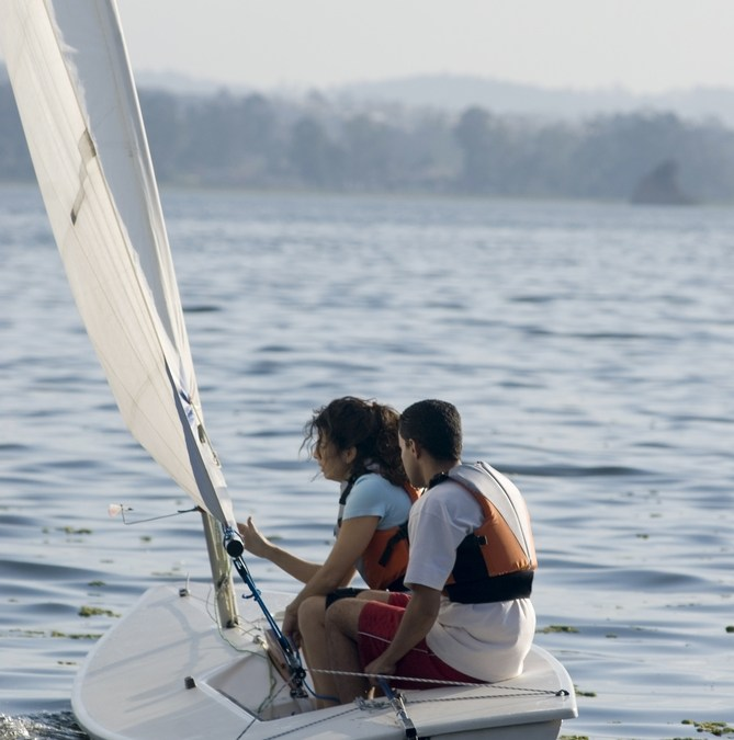 Two people sailing.