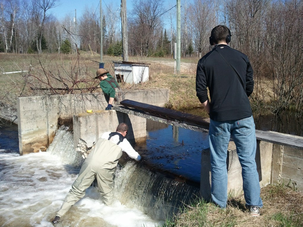 People work to remove a dam
