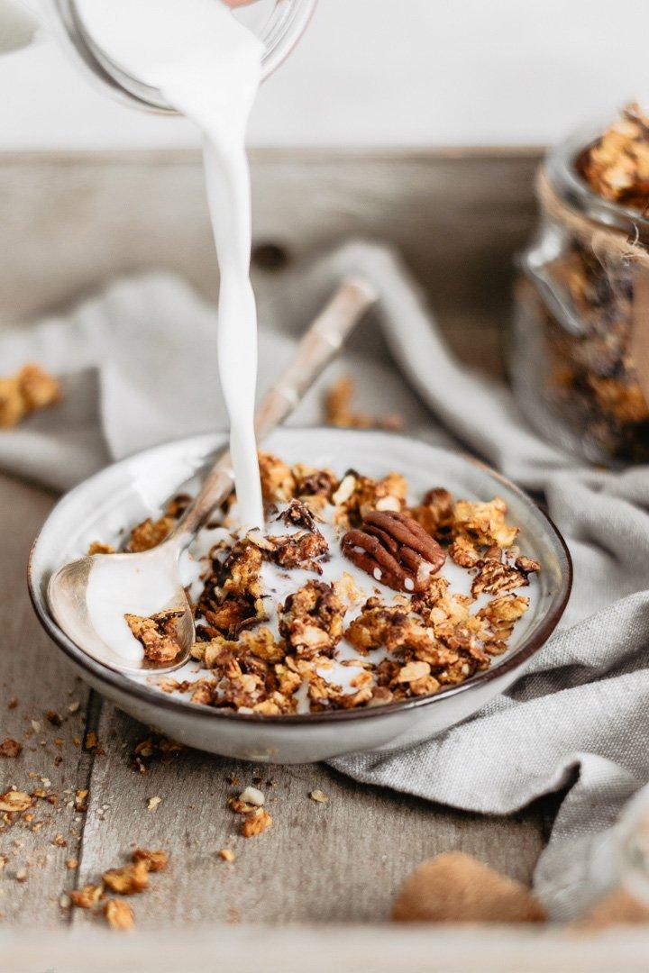 Delicious healthy pumpkin granola with chocolate, cinnamon and pecans