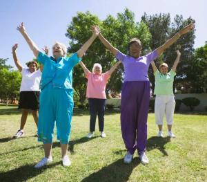 May 2004 --- Senior Women Exercising --- Image by © Royalty-Free/Corbis