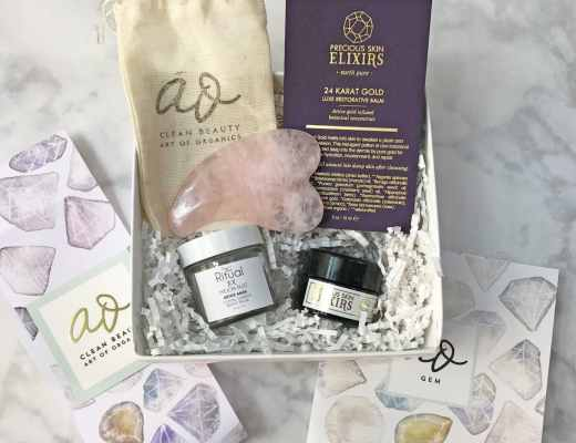 Picture of the December 2016 Art of Organics Monthly Luxury Clean Beauty Box. It includes The Ritual Moon Dust Crystal Charged Detox Mask, precious skin elixirs 24 karat gold luxe restorative balm and a rose quartz facial massager.