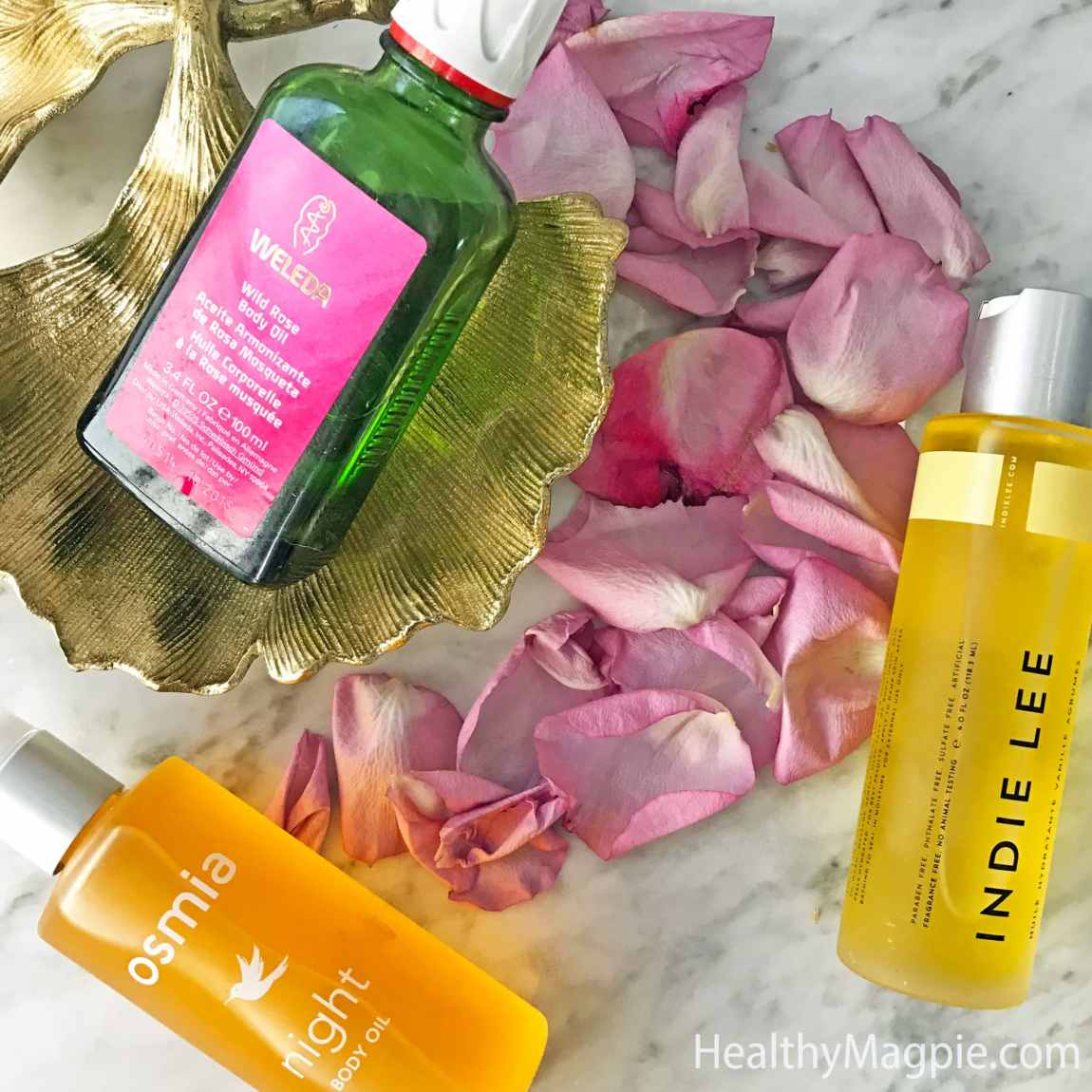 Pictures and reviews of Weleda wild rose body oil, Osmia organic night body oil and Indie Lee Vanilla Citrus moisturizing oil