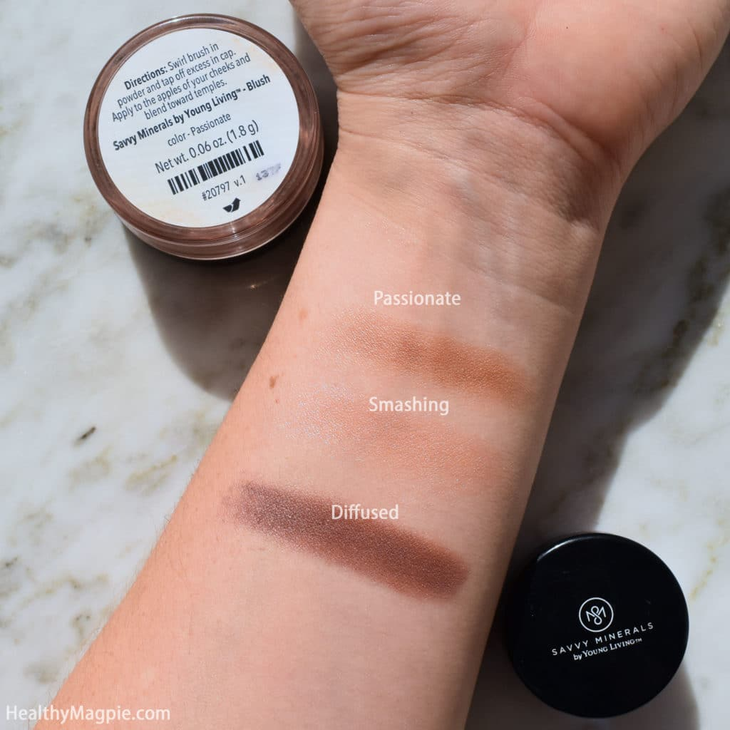 Picture and swatches of Savvvy Minerals by Young Living talc-free paraben free mineral makeup blushes and eyeshadow in Passionate, Smashing and Diffused. The colors are beautiful and consistency is similar to BareMinerals.