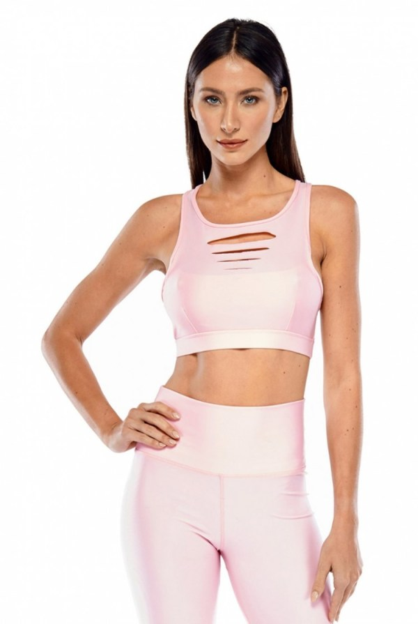 Featuring a Blush color, with a high-cut neckline, laser cut detailing, and a X-back strap design, this bra top is perfect for Yoga or the gym