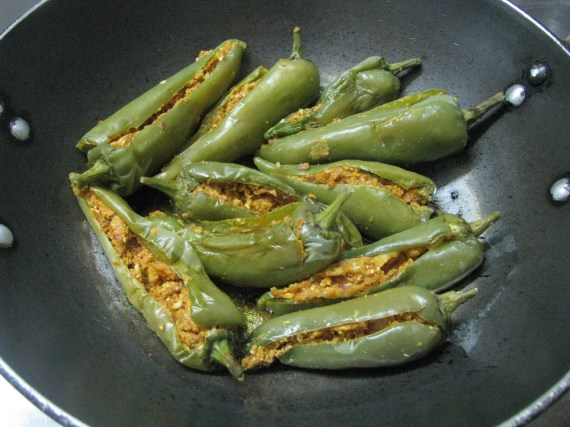 Roast cooked stuffed mirch/ marcha / mirchi in oil cumin seeds / asfoetidia