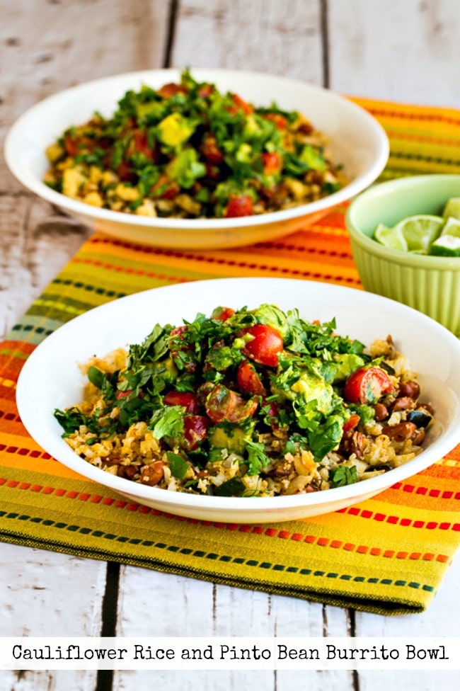 Cauliflower Rice and Pinto Bean Burrito Bowl photo of two finished bowls with text overlay