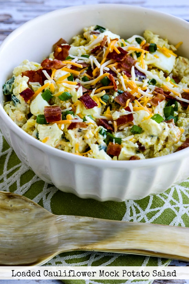 Loaded Cauliflower Mock Potato Salad in serving bowl, text overlay photo
