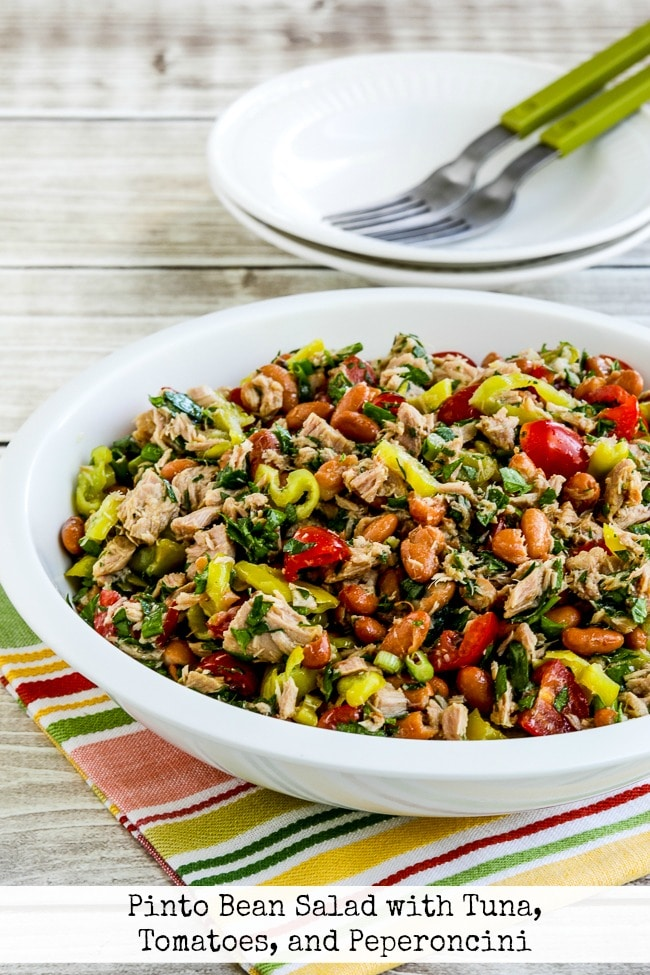 Pinto Bean Salad with Tuna, Tomatoes, and Peperoncini finished salad in bowl text overlay photo