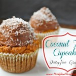 coconut flour cupcakes sitting on a white plate and topped with coconut