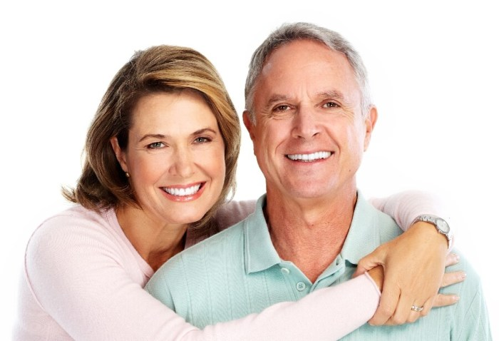 Middle aged man and woman listening and smiling