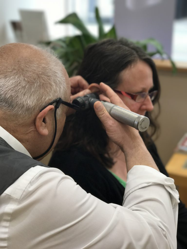 Martyn performing otoscopy