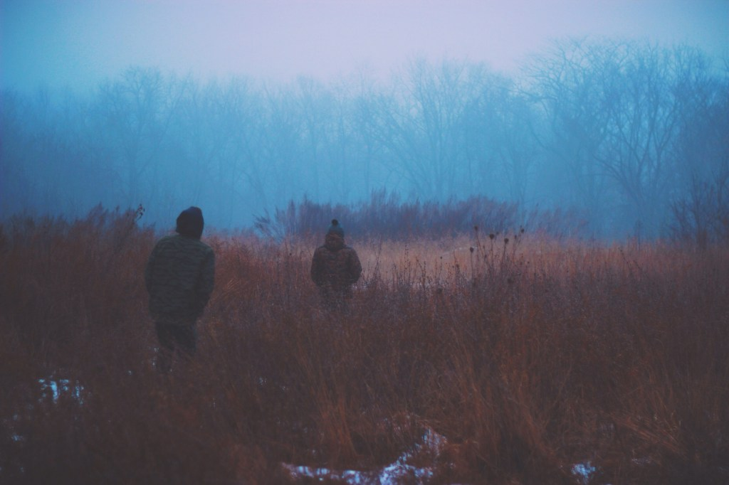 Young people in mist