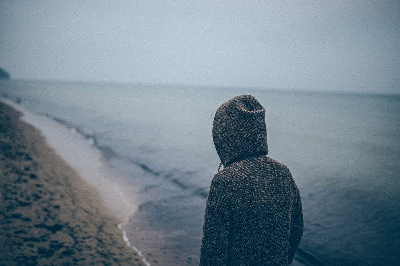 Person by sea image