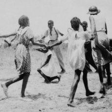 Zora Neale Hurston and children playing singing games, Eatonville, Florida, 1935