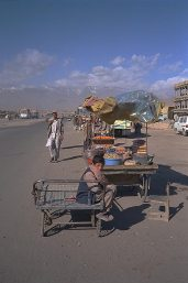 Kabul street with ruins