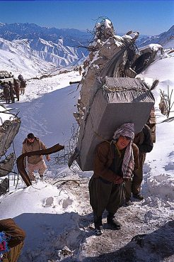 Carrying packs into Salang tunnel