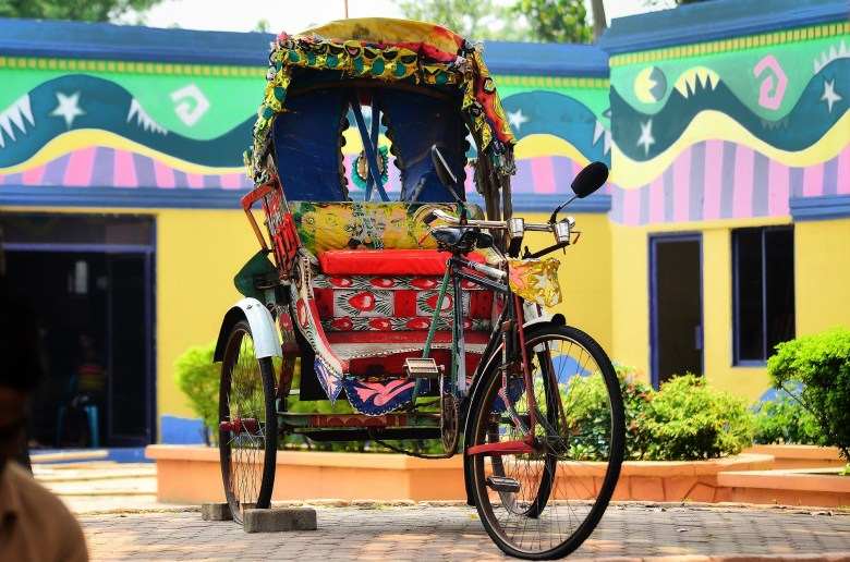 Soak in the culture of Dhaka by taking a slow ride on one of these painted rickshaws
