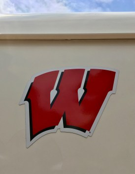 "Image of the ""Wisconsin W,"" logo of the University of Wisconsin-Madison's sports teams, against a white background (on the side of an ice cream truck)."
