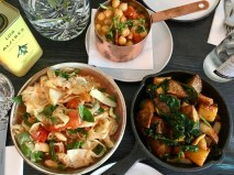 Three dishes from a tapas menu: fennel and tomato salad; roasted potatoes and spinach; and warm chickpeas.
