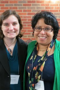 This photo from the 2014 Watson Conference shows the two of us—Beth Godbee (left) and Rasha Diab (right)—standing side-by-side; wearing a mix of blue, black, and green; in front of a brick wall.