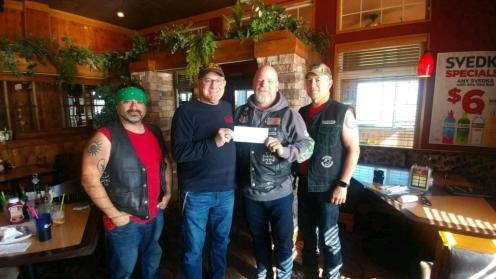 Nemesis presenting fundraising check to Heartbeat. From L to R: Peso, Heartbeat Board of Directors Charles, Dave and Rob