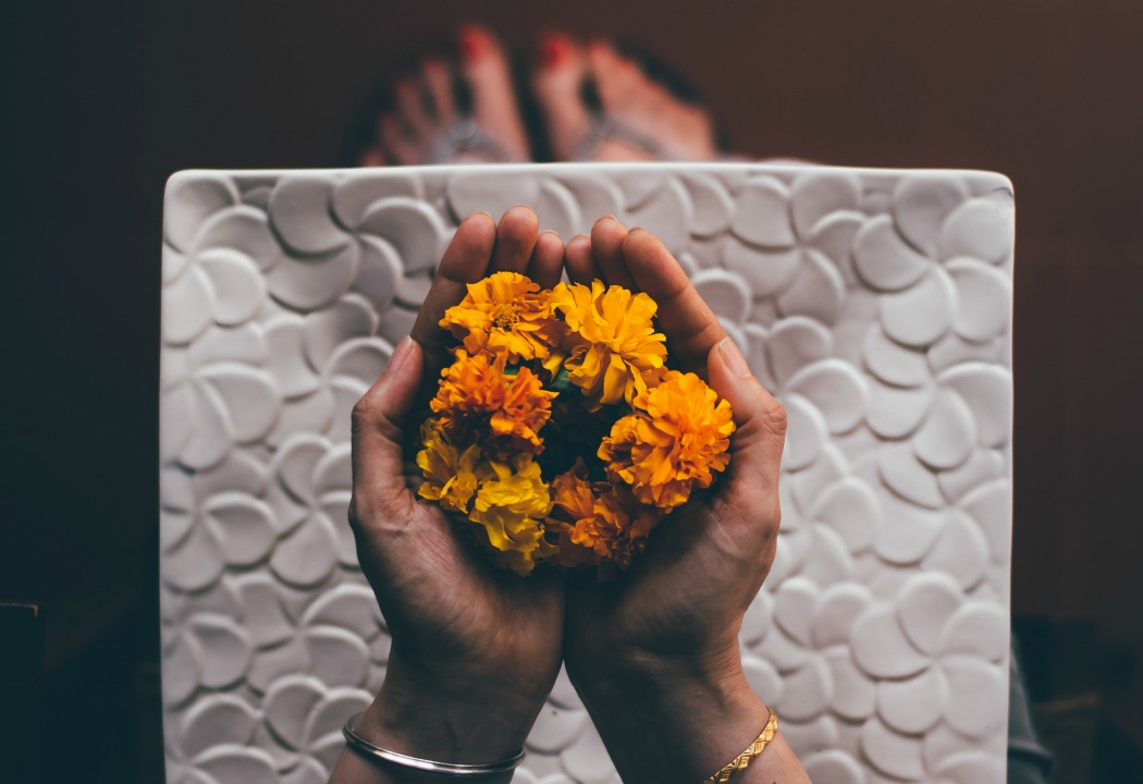 Bird's eye view of person holding flowers, used on blog about how someone healed from heartbreak