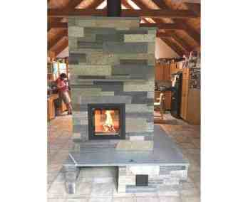 double-bell masonry heater with custom stone facing.  Project lead and designed by Homestead Heat.