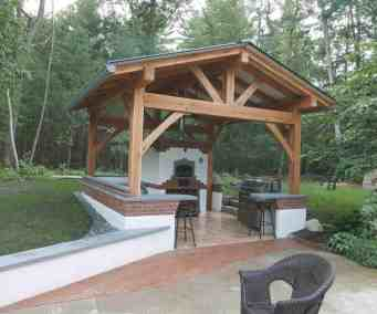 White Oak timber frame over custom outdoor kitchen.  Project lead by Homestead Heat.