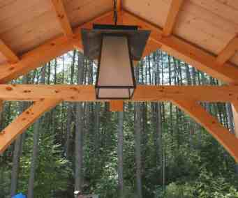 king-post truss frames a covered porch