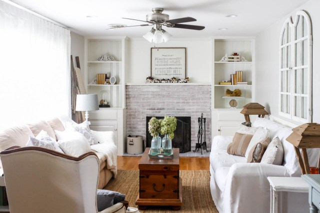 Living room fire place. built in cabinets around fired place. Wood burning fireplace. Dough Bowl decor. Window wall decor. DIY dropcloth slip cover. How to bleach dropcloth