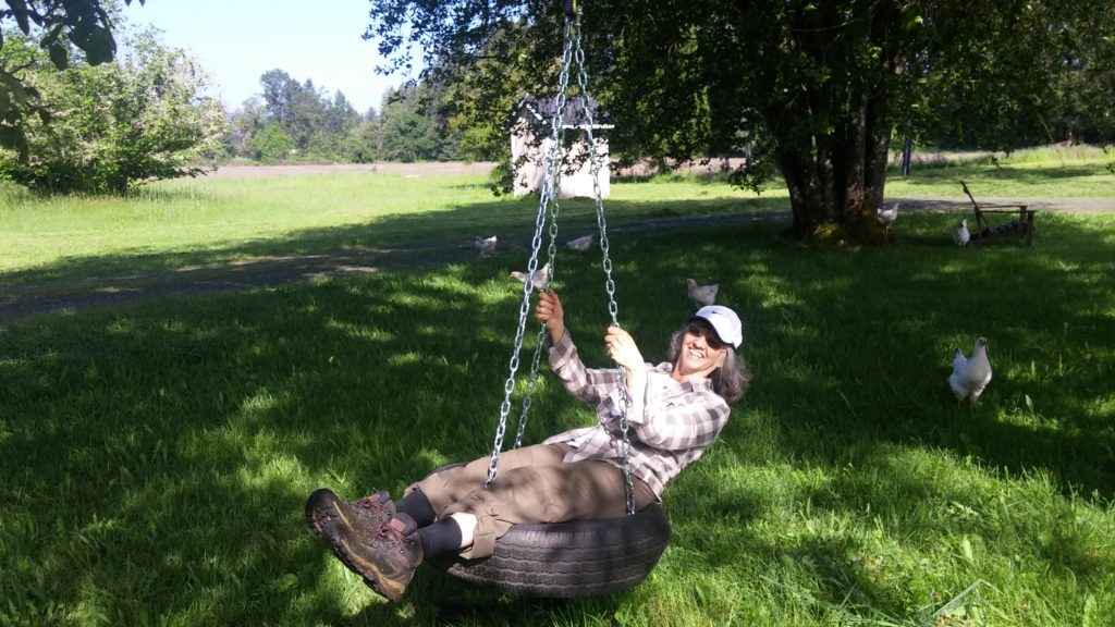 Rhenda enjoying emotional wellness on a swing