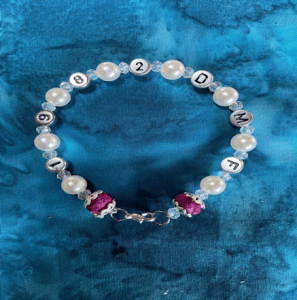 Personalized w/Individual's Initials, their flowers and date. Enhanced with pearls.