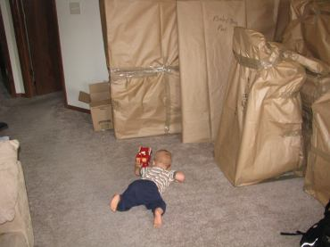 Z driving his firetruck around all of our wrapped up belongings.