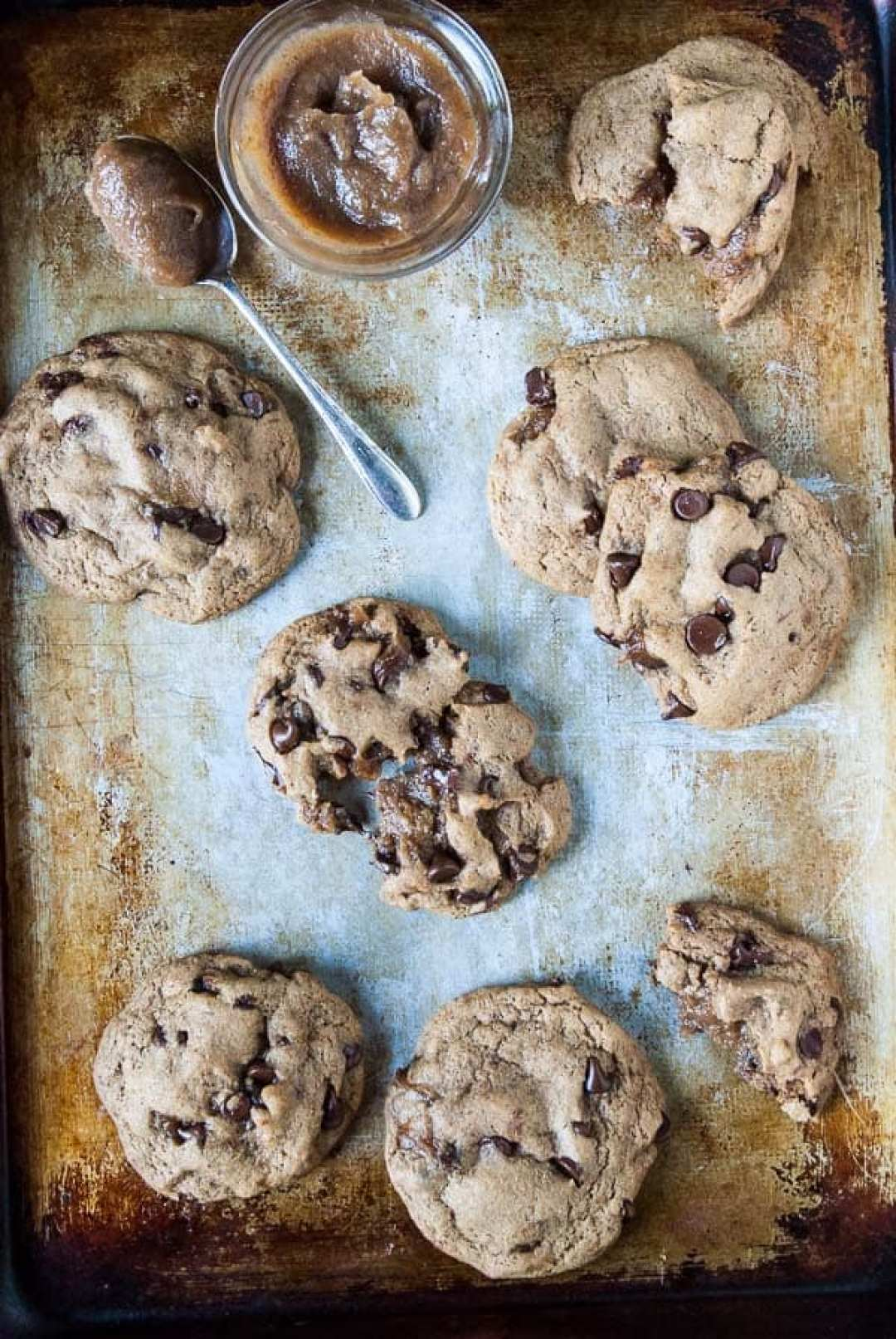 Vegan caramel chocolate chip cookies get stuffed with a date vegan caramel center and plenty of chocolate. Ready in under an hour and easy as pie!