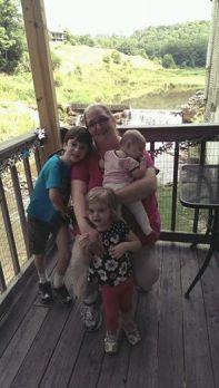 Momma Ali with three children.