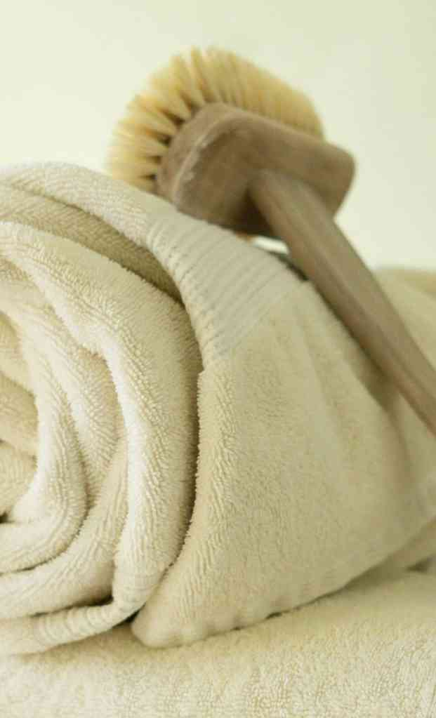 wooden brush and towel