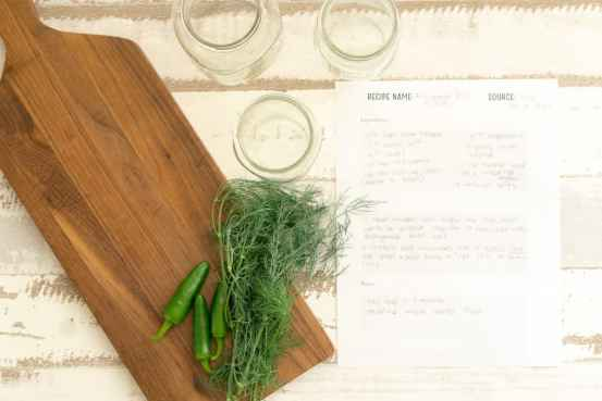 canning planner printable recipe page next to mason jars