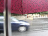 Waiting for the bus in the rain is no fun, though