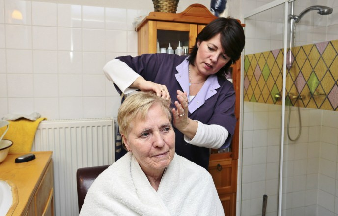Caregiver brushing hair