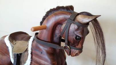 heirloom hand carved wood rocking horse with walnut wood, hand made english saddle and bridle, all leather