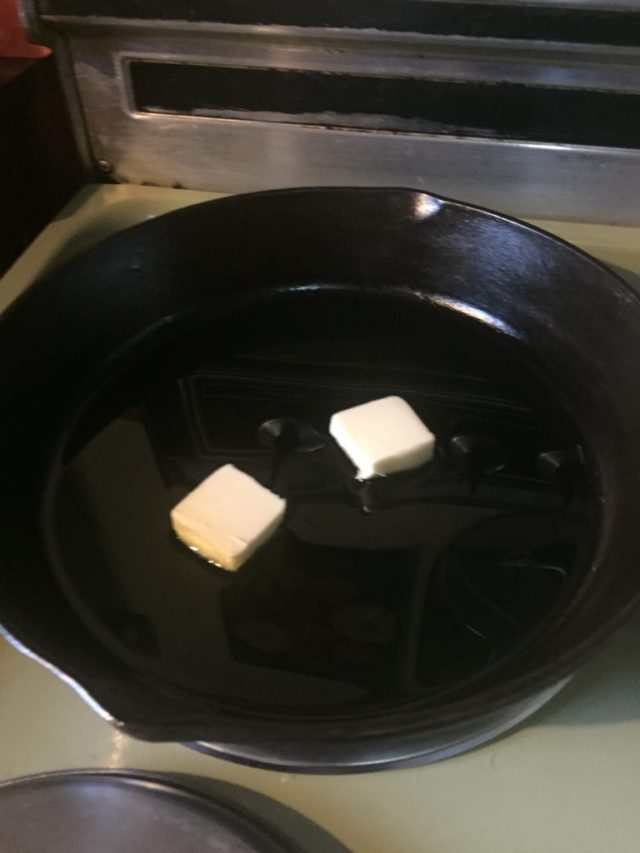 Butter and olive oil heating in the pan