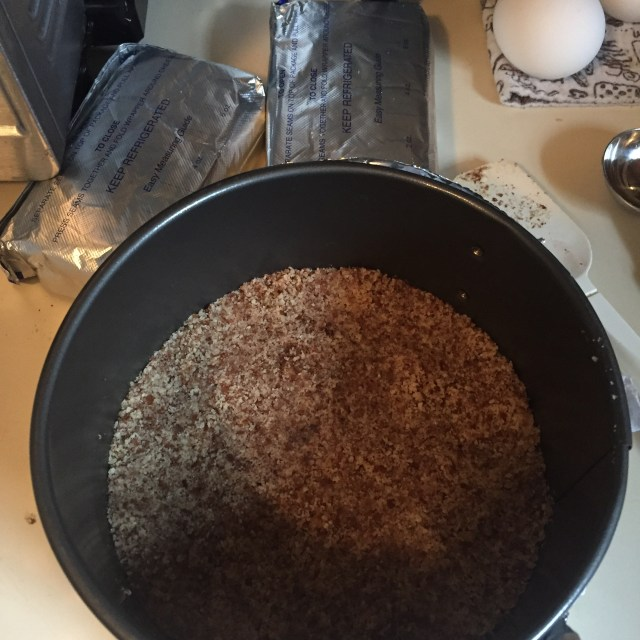 Keto nut crust in the bottom of the springform pan