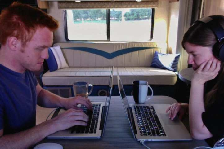 Heath and Alyssa working in the RV.
