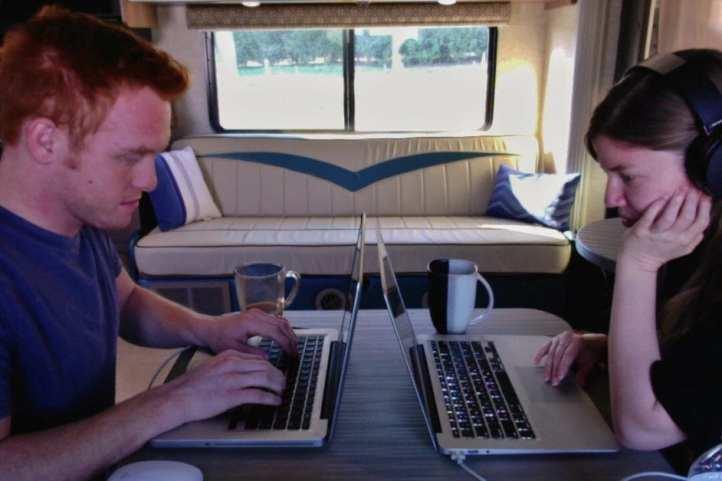 Heath and Alyssa working in the RV.