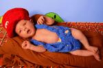 Newborn Super Mario Photoshoot of baby dressed like Mario