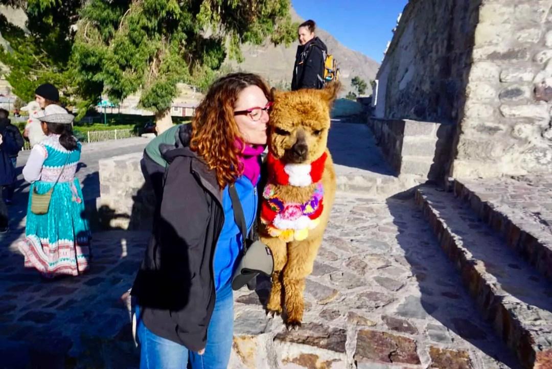 Kissing a llama in Peru