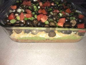 7-layer taco dip #mexicanfood #dips #heatherearles #herbnwisdom #guacamolerecipe #naturalliving #dinnerideas #podcaster #healthblogger #author #7layertacodip